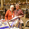 Peggy and Arlin at Cabela's with the quilt that Peggy made and donated to the club as a fund raiser.