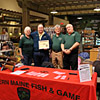 Peggy, Greg (Event Coordinator for Cabela's) Arlin and Jody. Arlin presented Greg with  a certificate of appreciation for his help with WMF&G.